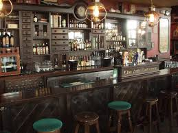 captivating design irish pub with dark wooden bar room table and wooden round bar stool also agreeable home bar design