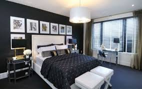 Black bed with white furniture White Nightstand Cb2 Mix Patterns In Black Bedroom
