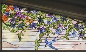 custom trumpet vine birds and erflies stained glass window