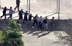 in this image from students from the marjory stoneman douglas high school in parkland fla evacuate the school after the shootings wednesday