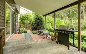 A semi-enclosed patio or porch could be a good compromise in locations that  are hot and humid.