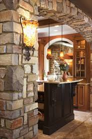 country kitchen column spout: stone column and arch going to kitchen beautiful so warm