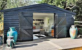 outside office shed. the experior cladding was finished with black sadolin woodshield superior flexible paint sadolinco outside office shed u