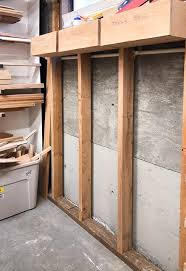 exposed studs for between the studs storage shelves