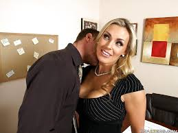MILF with huge tits Tanya Tate is fucking a big cock in the office.