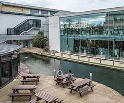 google head office images. a view of the benches duckpond and surrounding buildings at next head office google images