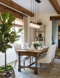in the breakfast room of the d design house which is adjacent to the kitchen decorator sarah wessel used a french farm table lee industries dining