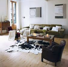 appealing faux animal skin rugs with sofas and wooden laminate floor for living room interior design