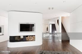 modern living room with fireplace. Modern Living Room With Parquet Floor And Fireplace Stock Photo | Getty Images I