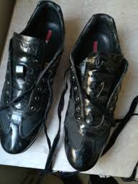 prada sneakers in patent leather and black canvas