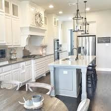kitchen island lighting design. white farmhouse kitchen with soft grey island like two different colors of granite tops lighting design h