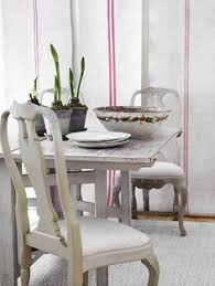 farm table with frenchy chairs