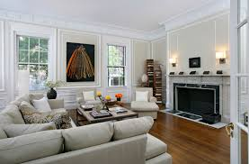 living room wainscoting ideas living room transitional with wood floor wall sconces marble fire place