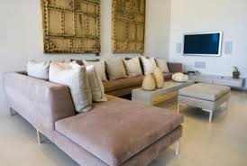 Breaking up a sectional sofa can make a room more comfortable for  conversation.
