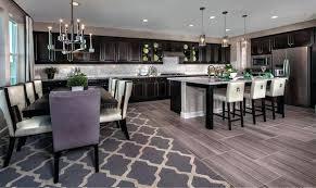 kitchen with dark cabinets beautiful traditional dark cabinet kitchen with modern chandelier white kitchen cabinets dark wood floors