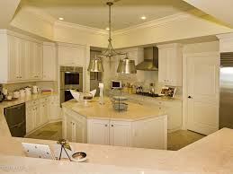 limestone tiles kitchen: traditional kitchen with limestone tile floors ceramic tile limestone counters pendant light