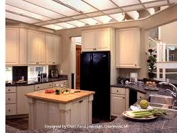 painted cabinetry and overhead arbor define the space in this spacious setting