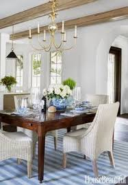 dining room decor ideas transitional coastal style with blue and white color palette gold chandelier vine indian dhurrie dark wood table and white