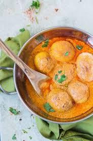 mix and stir kashmiri dum aloo baby potatoes cooked in yogurt gravy