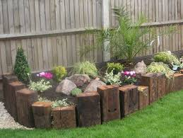 Railway Sleepers Positioned Vertically Constructing a Beautiful Edge For a  Raised DIY Garden Bed Edging Ideas Ready to Emphasize Your Greenery