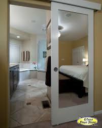 barn door to master bathroom with mirror on both sides