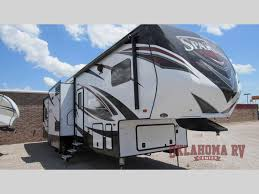 check out the spartan toy hauler fifth wheel