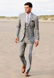 Go for a grey three piece suit and a white oxford shirt like a true gent