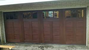 Fake wood carriage house garage doors - YouTube