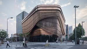 It was inspired by Chinese theaters with bamboo-like bronze tubes set in  three layers around the perimeter, constituting what the designers describe  as a ...