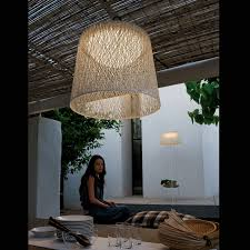 large pendant lighting. A Large Wind Pendant Light Over An Indoor Seating Area Lighting
