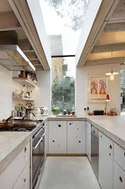 White Marble Floor Kitchen Wide Fixed Skylights White Cabinets Marble Flooring Pendant Lights