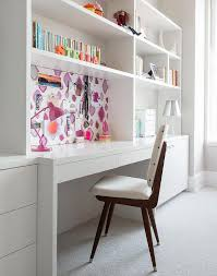girl room with white lacquered built in desk with wallpapered pin board