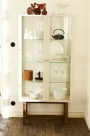stockholm furniture ikea. stockholm glass door cabinet in beige filled with glasses and plates by ikea stockholm furniture ikea
