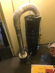 carbon filter hooked up 6 spacers on a standard 5 gallon blackout 4 in inline fan to help pull into the filter shes humming pretty good
