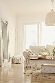 coastal decor lighting. Beachy Decorating Abeachcottage.com Coastal Vintage Style White Sofa, Wicker Pendant Lamp, Jute Rug, Door, Nautical Stripe X Decor Lighting A