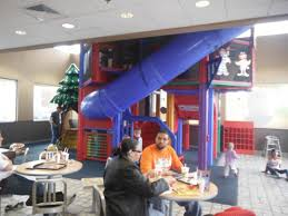 mcdonalds play place inside. Couple Sits At Table In Front Of Fourstory Indoor Play Area Throughout Mcdonalds Place Inside