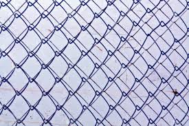 chain link fence texture. Abstract Chain Link Fence Texture Against Grungy Color Wall. Background And For Design Stock L