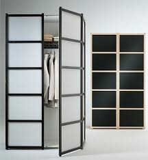 small closet design with frosted glass bifold doors and wooden frame ideas