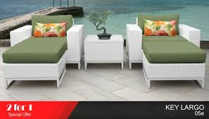 white wicker chairs and ottoman
