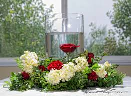 wedding centerpieces 003 towering and large centerpiece with red rose submerged in gl cylinder vase topped with a large red rose and white orchid