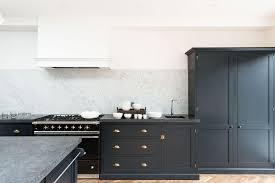shaker cabinets in a darker hue in devol s victoria road kitchen photograph courtesy of devol