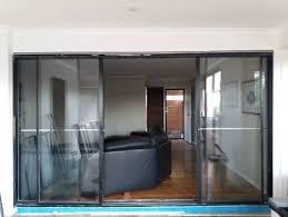 large black aluminium sliding door with fly screen