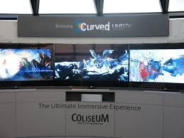 samsung curved tv in living room. samsung curved uhd coliseum tv in living room