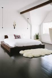 dark hardwood floors bedroom. Brilliant Floors Minimalist Decor With Dark Wood Floors And A Fur Rug Intended Dark Hardwood Floors Bedroom
