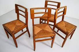 oak cane dining chairs from pierre