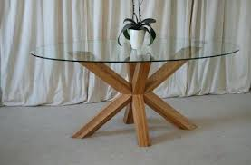 round glass and oak dining table oak and glass round dining table with crossed legs