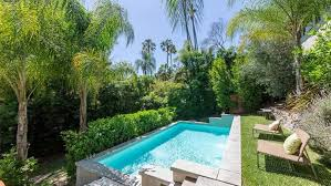 best swimming pool designs. Best Swimming Pool Landscaping Plants With Palm Trees And Chairs Designs N