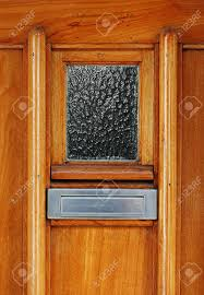 Classic Shiny Wooden Door With Silver Colored Mailslot Or Mailbox ...