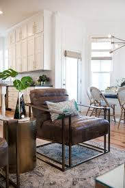 for a botantical meets contemporary style try adding a leather chair to your living room with splashes of greenery