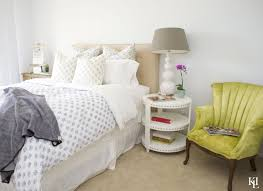 coastal beach house bedroom with yellow accent chair